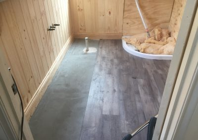 During the laying process for vinyl flooring